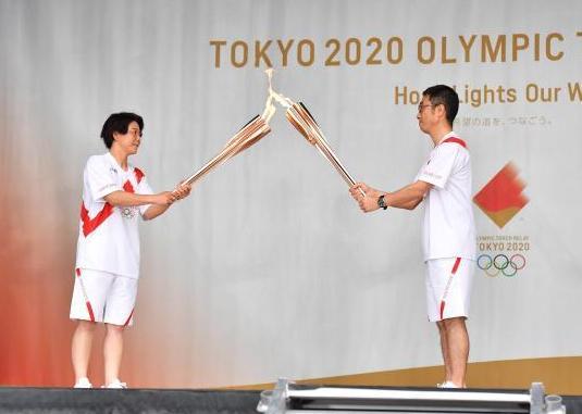 奥运圣火开始在东京都传递 奥运圣火抵达东京取消公共道路圣火传递